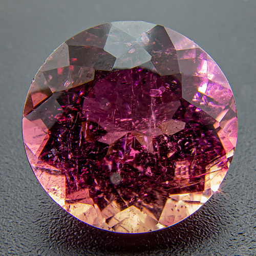 Tourmaline (Rubellite) from Brazil. 5.28 Carat. Round, distinct inclusions