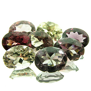 Tourmaline. 7.86 Carat. 7pcs (1pc less than depicted!), mixed lot, 6pcs pink and purple, 1pc pale yellow, 1pc of the lot is almost colourless, clarity from very, very small inclusions to small inclusions